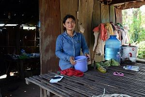 Ms Ren Ruon, 40, a villager in Kampong Cham province, uses a microloan to finance her small business selling fruit to factory workers. However, she admits she loses sleep sometimes thinking about the land that she could lose as collateral if she ever