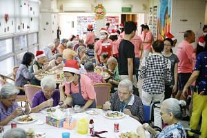 """Mr Anson Ng, a 50-year-old car dealer, serving the food he prepared with the help of volunteers to Mr Yip Heng Tuck, a 54-year-old terminally ill patient at the Dover Park Hospice, last Friday. """"I find it meaningful to help make each meal good in cas"""