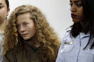 Palestinian Ahed Tamimi (left) appears at a military court at the Israeli-run Ofer prison, Dec 28, 2017.