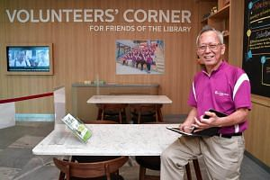 Mr Ho Hew Lee, who volunteers at the library teaching seniors how to use technology.