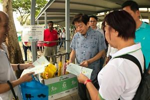 "Sembawang GRC MP Khaw Boon Wan at the official launch of the Sharella or ""Share an umbrella"" initiative on Dec 30."