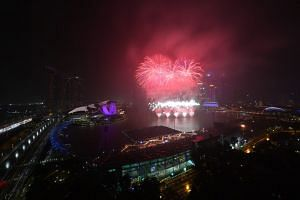 Fireworks burst over the skyline at midnight for the New Year 2018 celebrations in Singapore on Jan 1, 2018.