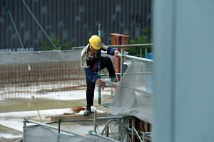 A construction worker on a building site near Paya Lebar Road.