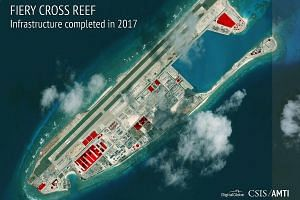 """An image showing infrastructure China has reportedly built on Fiery Cross Reef in the Spratlys. Experts see few signs that the South China Sea issue is a White House priority. The US will likely need to take its strategy on the issue off """"auto-pilot"""""""