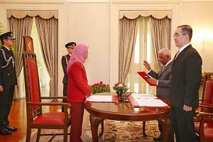 President Halimah Yacob officiating the swearing-in ceremony and appointment ceremony of Mr S. Dhanabalan (centre) to the Council of Presidential Advisers on Jan 3, 2018. Justice Tay Yong Kwang (right) was the witness.