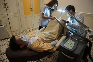 A promotional handout shows a man undergoing a penis whitening procedure at the Bangkok branch of Lelux Hospital.