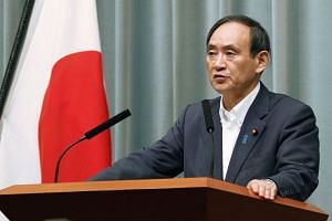 Chief Cabinet Secretary Yoshihide Suga said that Tokyo, Washington, and Seoul remained committed to applying maximum pressure on the secretive regime.