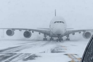 A Singapore Airlines Airbus A380, diverted from John F. Kennedy Airport during a winter storm, on the runway at Stewart International Airport in Newburgh, New York on Jan 4, 2018.