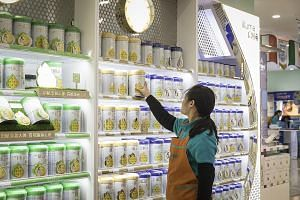 Cans of Illuma infant formula, produced by Nestle, at a Shanghai store. New rules in China governing the formula milk industry make it easier for foreign brands like Nestle to grab a greater share of a huge market.