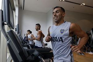 Carlos Tevez was pictured in the gym wearing a Boca team shirt although the club did not reveal the value of the transfer.