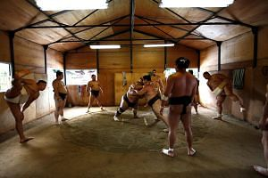 Sumo wrestlers attend a training session at a temple in Nagoya, Japan, on July 5, 2017.