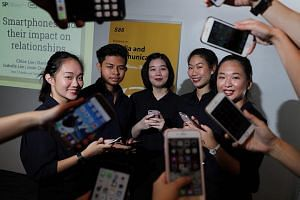 Singapore Polytechnic students Josin Chee, 18, Danial Hadi, 18, Lydia Wong, 22, Chloe Lee, 18, and Isabella Lim, 18, were the team that conducted and did research for the 'phubbing' survey.