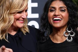 Actress Amy Poehler (left) and Saru Jayaraman, an attorney, author, activist and advocate for restaurant workers in the San Francisco Bay Area, at the 75th Golden Globe Awards on Jan 7, 2018.