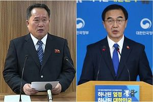 Delegation leaders for the two Koreas: Ri Son Gwon (left), chairman of North Korea's Committee for Peaceful Reunification, and Cho Myoung Gyon, South Korea's Unification Minister.
