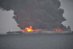 Smoke and fire is seen from a Panama-registered tanker carrying Iranian oil after it collided with a Chinese freight ship in the East China Sea.