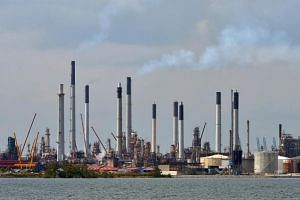 The men are suspected of misappropriating fuel from Shell's Pulau Bukom manufacturing site.