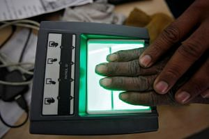 A villager getting his fingerprints scanned for the Unique Identification database system at an enrolment centre Rajasthan, India, on Feb 22, 2013.