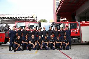 Some of the firefighters from Changi Fire Station, who helped trapped motorists and pushed vehicles out of flooded areas along Upper Changi Road on Jan 8.
