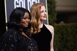 Actresses Jessica Chastain (right) and Octavia Spencer arrive for the 75th Golden Globe Awards.