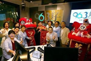 From left: DJ Anna Lim, producer Lee Wei Wei, DJs Wen Guo Xian, Chen Li Yi and Wang De Ming, SPH Radio general manager Sim Hong Huat (partially hidden), SPH deputy chief executive Anthony Tan, SPH Chinese Media Group head Lee Huay Leng, DJ Hong Wei W