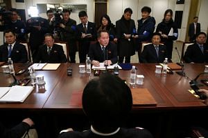 Ri Son Gwon, head of the North Korean delegation, talks with South Korean counterpart Cho Myoung-gyon during their meeting at the truce village of Panmunjom in the demilitarised zone separating the two Koreas on Jan 9.