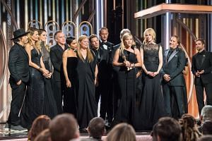 Reese Witherspoon (centre) accepting the Golden Globe award for Best Television Limited Series or Motion Picture Made for Television for Big Little Lies with cast and crew members.