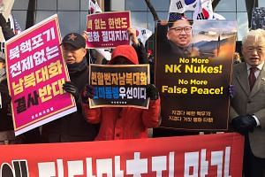 Members of conservative groups, who are against holding inter-Korean talks without the North abandoning its nuclear programme, at a rally in Seoul yesterday.