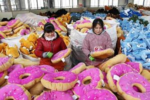 A toy factory in China. The World Bank says activity in East Asia will likely moderate as China transitions to slower but more sustainable growth.