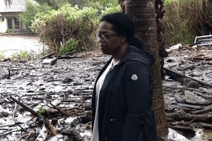 Oprah Winfrey posted videos on Instagram showing her wading through nearly knee-deep mud on her property and later inspecting the damage.