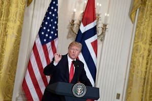 Trump speaks during a news conference with Prime Minister of Norway Erna Solberg.