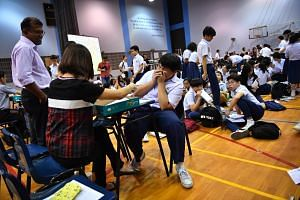 Presbyterian High School pupils receive their O-level examination results, on Jan 12.