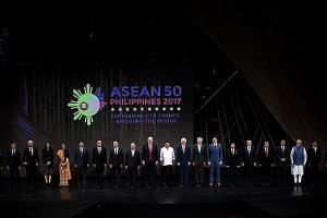 Asean delegates, world leaders and officials at the opening of the 31st Asean Summit in Manila on Nov 13. As chair of the grouping this year, Singapore has a plethora of plans, including getting Asean to work together to get tough on terrorism and cybercr