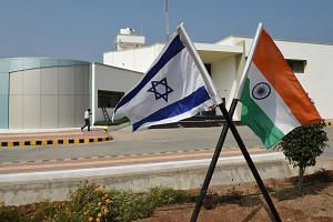 Israeli and Indian flags are displayed in Vadrad village, near Ahmedabad, ahead of a visit by Israeli Prime Minister Benjamin Netanyahu on Jan 17, 2018.