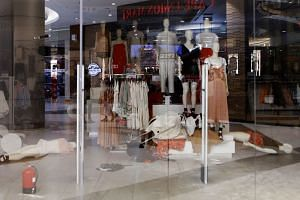 A store in Sandton City shopping mall in Johannnesburg is closed after being ransacked.