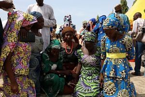 Some of the schoolgirls kidnapped by Boko Haram in Chibok reuniting with their families in Abuja, Nigeria, on May 20, 2017, after they were released. Around 100 of the abducted girls are still believed to be in captivity.