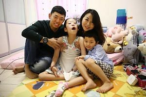 Mr Kenneth Mah and his wife Patricia with their children Chloe and Cayden. Nine-year-old Chloe has Pompe disease, which currently has no cure and can be fatal. Her treatment now easily reaches $40,000 a month.