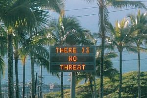 "Left: An electronic sign in Oahu, Hawaii, reads ""There is no threat"" after the false alert, which was not corrected for 38 minutes."