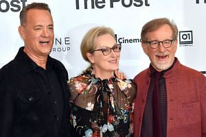 Actors Tom Hanks and Meryl Streep pose with Spielberg during a photocall for The Post in Milan, Italy.