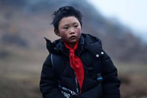"""Wang Fuman, also known as """"Frost Boy"""", braved frigid temperatures to reach his school in rural Zhaotong for the final examinations."""