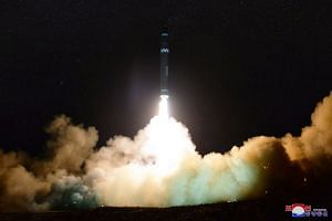 North Korea's newly developed ICBM Hwasong-15 takes off in a photo released Nov 30, 2017.