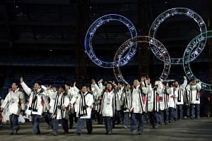 South Korean and North Korean athletes marching together during the opening ceremony of the 2006 Winter Olympics at the Olympic stadium in Turin.