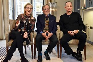 Spielberg (centre) and the film's stars Meryl Streep (left) and Tom Hanks are interviewed about The Post.