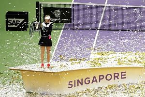 Denmark's Caroline Wozniacki celebrating with the trophy after winning last year's WTA Finals. Singapore has hosted the US$7 million (S$9.3 million) tournament, which features the world's top eight women's singles players and doubles teams, since 201