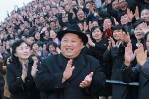 North Korean leader Kim Jong-Un (centre) visiting the newly-renovated Pyongyang Teachers' University in Pyongyang.