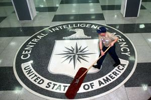 A worker sweeping the foyer clean at CIA Headquarters, Langley, Virginia.