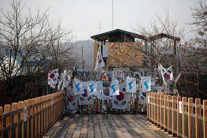 Unification flags hang on a military fence near the Demilitarized Zone separating the two Koreas in Paju, South Korea, on Jan 19, 2018.