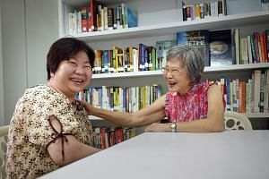 Madam Tan Ow Lang (right), 73, with Madam Tje A Sui, 52, at the Hannah Seniors Activity Centre. Madam Tan visits Madam Tje, a former stroke patient, up to twice a week to provide emotional and practical support.
