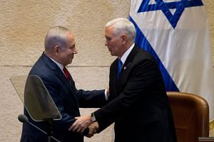 Israel's Prime Minister Benjamin Netanyahu (left) with US Vice-President Mike Pence in Israel's Parliament in Jerusalem, on Jan 22, 2017.