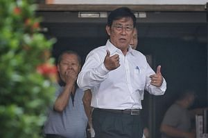 Veteran athletics coach Loh Siang Piow, who is accused of using criminal force and molesting the teen, outside the State Courts yesterday.