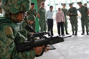 President Halimah Yacob observes as recruits undergo SAR21 Technical Handling Training during her first visit to an SAF unit at the Basic Military Training Centre on Pulau Tekong on Jan 23, 2018.